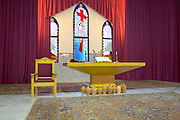 """LEBANON, BEIRUT:  Altar of Christian Protestant church in Beirut with """"Cedars of Lebanon"""" stained glass windows."""