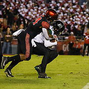 24 November 2018: San Diego State Aztecs linebacker Kyahva Tezino (44) sacks Hawaii Warriors quarterback Cole McDonald (13) in the first quarter. The Aztecs closed out the season with a 31-30 overtime loss to Hawaii at SDCCU Stadium.