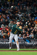 Oakland Athletics third baseman Matt Chapman (26) throws to first base against the San Francisco Giants at AT&T Park in San Francisco, California, on March 26, 2018. (Stan Olszewski/Special to S.F. Examiner)
