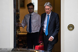 © Licensed to London News Pictures. 12/03/2018. London, UK. The Chancellor of The Exchequer Philip Hammond (R) leaves 11 Downing Street on the eve of the Spring Statement. Photo credit: Rob Pinney/LNP