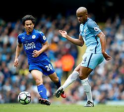 Vincent Kompany of Manchester City and Shinji Okazaki of Leicester City - Mandatory by-line: Matt McNulty/JMP - 13/05/2017 - FOOTBALL - Etihad Stadium - Manchester, England - Manchester City v Leicester City - Premier League