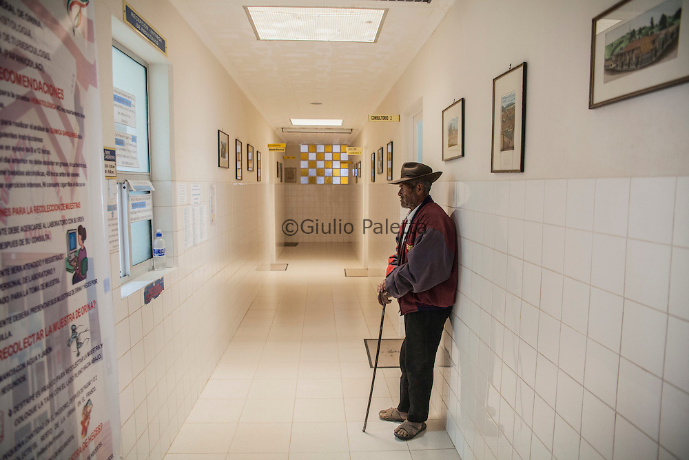 A patient inside the waiting room of Pietro Gamba's hospital in Anzaldo, near Cochabamba, in the Bolivian Andes