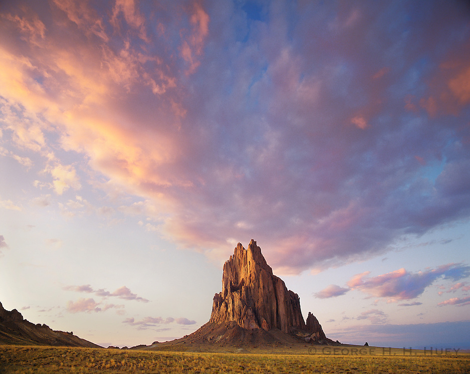 0299-1000LVT ~ Copyright: George H. H. Huey ~ Shiprock, 1100 foot high volcanic monolith or 'Rock with Wings' as some Navajo Indians call it. Navajo Indian Reservation, New Mexico.
