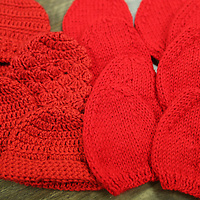 Lauren Wood   Buy at photos.djournal.com<br /> A group of knitters and crocheters made 250 red caps for newborn babies at the NMMC Women's hospital.
