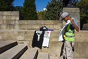 Philadelphia, Pennsylvania - September 17, 2015: Stephen Lewis Richards sells Rocky shirts, Pope Shirts and water by the Philadelphia Museum of Art Thursday September 17, 2015. <br /> <br /> Scott Mirkin's company ESM is heading the production of The World Meeting Of Families and Pope Francis's visit to Philadelphia this Fall. The events will take place along the Benjamin Franklin Parkway.<br /> <br /> CREDIT: Matt Roth for The New York Times<br /> Assignment ID: 30179397A