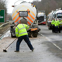 RTC on A9 at Dunkeld....25.02.09<br /> Raw sewage is spread all over the main A9 by Dunkeld Railway Station after two Scottish Water lorries collided at around 9.45am this morning, workers are pictured started the clean up <br /> Picture by Graeme Hart<br /> COPYRIGHT: Perthshire Picture Agency.<br /> Tel. 01738 623350 / 07990 594431