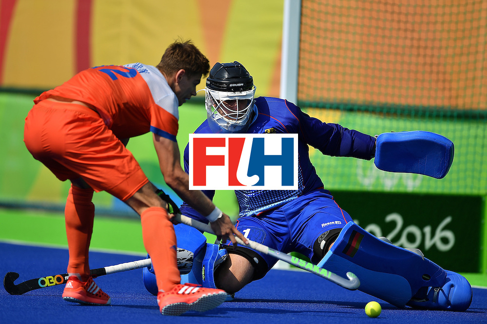 RIO DE JANEIRO, BRAZIL - AUGUST 18:  Goalkeeper of Germany Nicolas Jacobi saves the shot from Sander De Winj to win the penalty shoot out and Bronze medal during the Mens's Bronze medal match between the Netherlands and Germany on Day 13 of the Rio 2016 Olympic games at Olympic Hockey Center on August 18, 2016 in Rio de Janeiro, Brazil.  (Photo by Pascal Le Segretain/Getty Images)