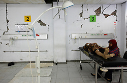 An Indonesian earthquake victim lies in the broken down interiors of Jamil Hospital which collapsed partly in Padang, West Sumatra, Indonesia 02 October 2009. Rescue workers were searching Friday for survivors and bodies under the rubble of collapsed buildings in Indonesias West Sumatra as the United Nations estimated 1,100 people were killed in the massive earthquake.
