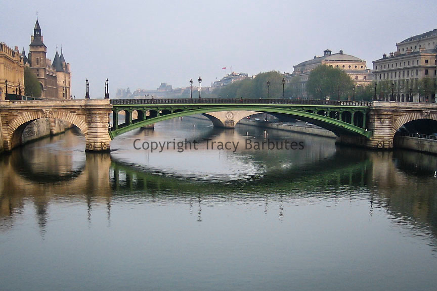 A bridge over the Seine River early morning with the Conciergerie in the background, Paris, France