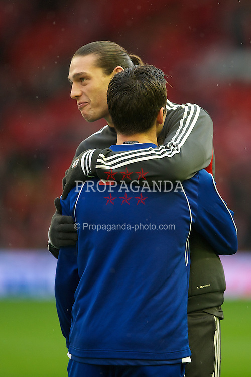 LIVERPOOL, ENGLAND - Saturday, December 10, 2011: Liverpool's Andy Carroll and Queens Park Rangers' Joey Barton chat before the Premiership match at Anfield. (Pic by David Rawcliffe/Propaganda)