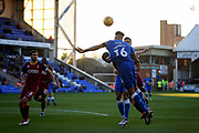 Peterborough United defender Rhys Bennett (16) with a header at the back post during the EFL Sky Bet League 1 match between Peterborough United and Bradford City at The Abax Stadium, Peterborough, England on 17 November 2018.