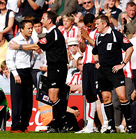 Photo: Alan Crowhurst.<br />Southampton v Leeds United. Coca Cola Championship. 21/04/2007. Leeds manager Dennis Wise is held back by the fourth official.