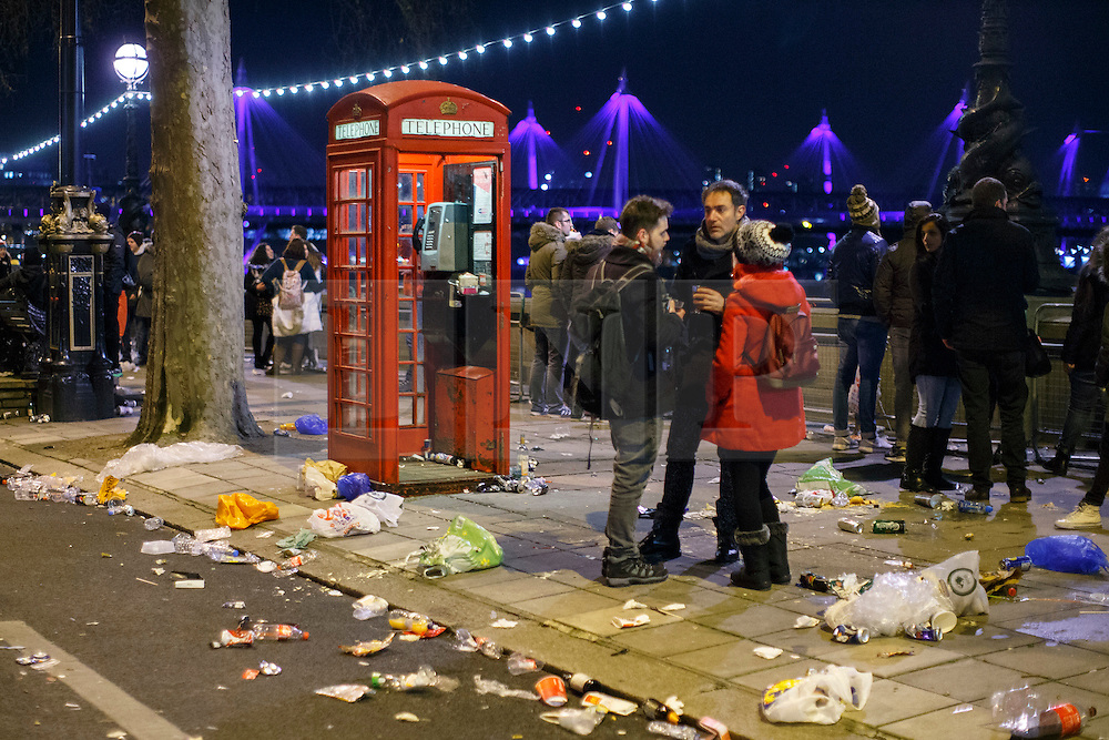 © Licensed to London News Pictures. 01/01/2016. London, UK. Revellers celebrating the New Year in central London at the first hours of 2016 on January 1, 2016. Photo credit: Tolga Akmen/LNP