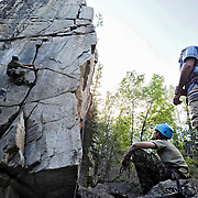 Ian Stewart/Yukon News<br /> Cadet Samuel Beauregard, from Quebec, climbs a rock face on Thursday as fellow cadets and intructors watch. More than 250 cadets from across Canada, as well as the United Kingdom, are spending the summer at the Whitehorse Cadet Summer Training Centre.