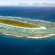Aerial panorama of Taula Island in the Vava'u island group of the Kingdom of Tonga. Taula is an elongated island, completely surrounded by fringing reef.