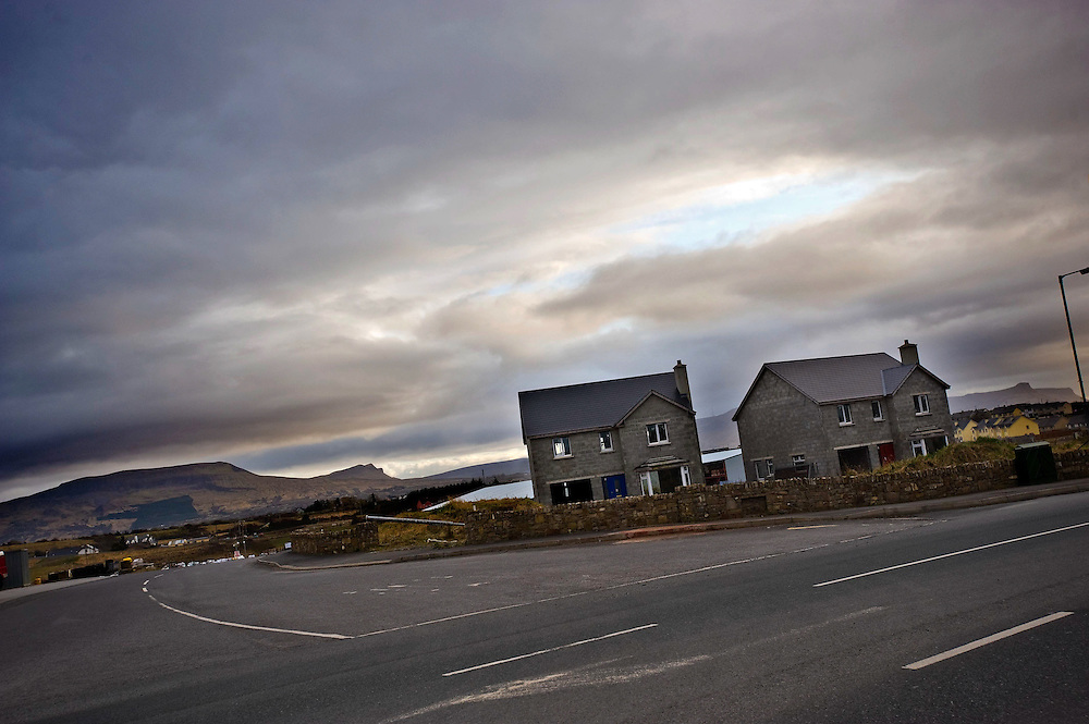 Two abandoned new build houses on the outskirts of Bundoran, Co Donegal, Ireland. It is estimates that post celtic tiger, there are 300,000 empty houses and over 600 ghost estates scattered acoross the counry with rural Ireland being the worst affected.
