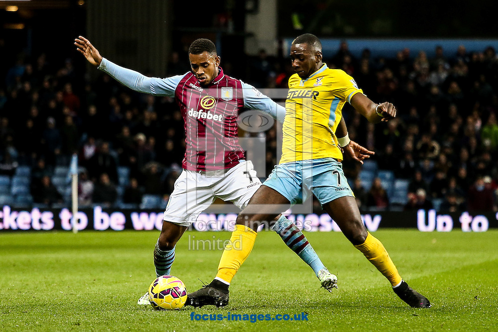 Leandro Bacuna of Aston Villa (left) competing with Yannick Bolasie of Crystal Palace (right) during the Barclays Premier League match at Villa Park, Birmingham<br /> Picture by Andy Kearns/Focus Images Ltd 0781 864 4264<br /> 01/01/2015
