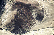 Aerial view of the astronaut. The Nazca Lines are a group of very large geoglyphs formed by depressions or shallow incisions made in the soil of the Nazca Desert in southern Peru. They were created between 500 BC and 500 AD.