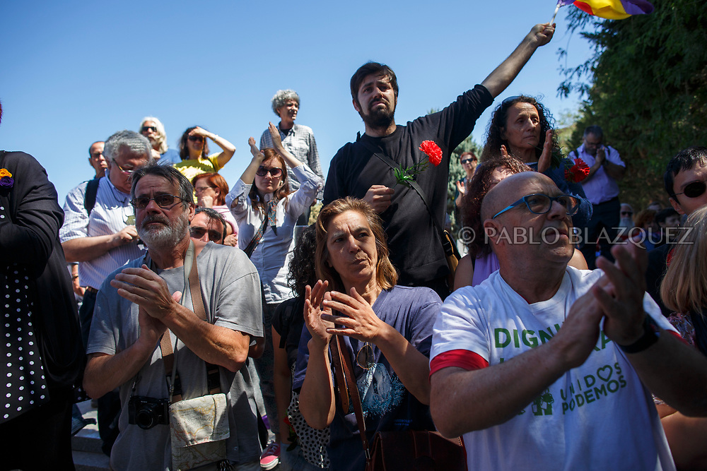 02/07/2017. People support Ascension Mendieta (not in the picture) during the burial of her father, Timoteo Mendieta, who was assassinated in 1939 by dictator Franco's forces at a cemetery on July 2, 2017 in Madrid, Spain. General Franco forces killed Ascension's father Timoteo Mendieta in 1939 after Spain's Civil War and buried him in a mass grave in Guadalajara's cemetery together with another 22 people assassinated. Argentinian judge Maria Servini used the international human rights law and ordered the exhumation and investigation of Mendieta's mass grave. The exhumation was carried out by Association for the Recovery of Historical Memory (ARMH). Spain's Civil War took the lives of thousands of people on both sides, but Franco continued his executions after the war has finished. Spanish governments has never done anything to help the victims of the Civil War and Franco's dictatorship while there are still thousands of people missing in mass graves around the country. (© Pablo Blazquez)