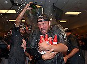 Baltimore Orioles pitcher Tommy Hunter is doused with champagne in the visitors clubhouse after the Orioles defeated the New York Yankees 5-2 in a baseball game to earn an American League wild card spot, Sunday, Oct. 2, 2016, in New York. (AP Photo/Kathy Kmonicek)