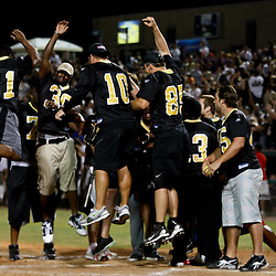 May 17, 2011; Metairie, LA, USA; New Orleans Saints rookie running back Mark Ingram (21) celebrates with teammates after hitting a homerun during the Heath Evans Foundation charity softball showdown featuring the offense versus the defensive players at Zephyrs Field.  Mandatory Credit: Derick E. Hingle