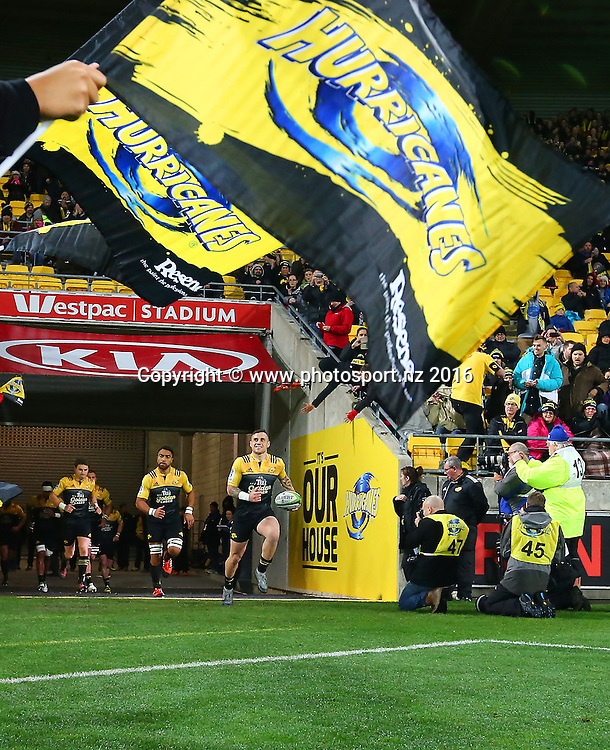 TJ Perenara leads out the Hurricanes during the Investec Super Rugby Semi-Final match, Hurricanes v Chiefs at Westpac Stadium, Wellington, New Zealand. 30th July 2016. © Copyright Photo: Grant Down / www.photosport.nz