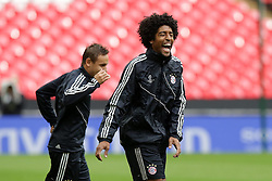 24.05.2013, Wembley Stadion, London, ENG, UEFA Champions League, FC Bayern Muenchen vs Borussia Dortmund, Finale, Training, im Bild DANTE (FC Bayern Muenchen - 4) lacht - ist gut gelaunt // during a training session prior to the UEFA Champions League final match between FC Bayern Munich and Borussia Dortmund at the Wembley Stadion, London, United Kingdom on 2013/05/24. EXPA Pictures © 2013, PhotoCredit: EXPA/ Eibner/ Gerry Schmit..***** ATTENTION - OUT OF GER *****