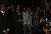 listening to performance by Indian Ocean , Other,Riyas Komu and Peter Drake. - VIP  launch of Aicon. London's largest contemporary Indian art gallery. Heddon st. and afterwards at Momo.15 Marc h 2007.  -DO NOT ARCHIVE-© Copyright Photograph by Dafydd Jones. 248 Clapham Rd. London SW9 0PZ. Tel 0207 820 0771. www.dafjones.com.