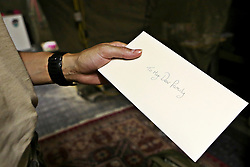 © Licensed to London News Pictures. 15/06/2012. Helmand. Known informally as a 'death letter', most women will write a message to their family which will be kept somewhere safe and only delivered if the worst should happen. Army women 'engagement officers' working in Afghanistan. Trained in Pashto, the Afghan language, they accompany infantry on patrols and build relationships with Afghan women in some of the most dangerous parts of Helmand. Photo credit : Alison Baskerville/LNP