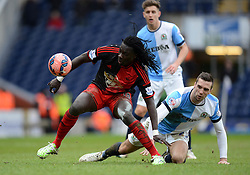 Swansea City's Bafetimbi Gomis competes with Blackburn Rovers's Shane Duffy - Photo mandatory by-line: Richard Martin Roberts/JMP - Mobile: 07966 386802 - 24/01/2015 - SPORT - Football - Blackburn - Ewood Park - Blackburn Rovers v Swansea City - FA Cup Fourth Round