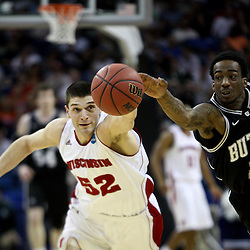 Mar 24, 2011; New Orleans, LA; Butler Bulldogs guard Shawn Vanzant (2) steals the ball from Wisconsin Badgers forward Keaton Nankivil (52) during the first half of the semifinals of the southeast regional of the 2011 NCAA men's basketball tournament at New Orleans Arena.  Mandatory Credit: Derick E. Hingle