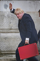 © Licensed to London News Pictures. 15/07/2016. London, UK. New Foreign Secretary Boris Johnson waves as he arrives at the Foreign Office via the Ambassadors Entrance.  Photo credit: Peter Macdiarmid/LNP