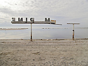 abandoned marina sign at water edge