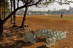 March 27, 2019 - Mumbai, India - A man walks past bottled water in Mumbai, India on 27 March 2019. As per the information provided by a www.bottledwaterindia.org, There are 5,735 licensed bottlers for packaged drinking water across India, alongside uncountable unbranded ones. (Credit Image: © Himanshu Bhatt/NurPhoto via ZUMA Press)