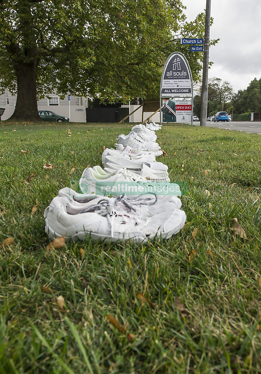 March 30, 2019 - Christchurch, Canterbury, New Zealand - Fifty pairs of white painted shoes line the footpath outside All Souls Anglican Church in memory of the 50 people killed March 15 in the city mosque macssacre. The display is similar to the 185 white painted chairs that were set up elsewhere in memory of people killed in the 2011 earthquake here. (Credit Image: © PJ Heller/ZUMA Wire)
