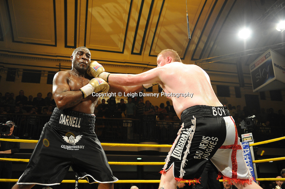 Michael Sprott (black shorts) defeats Danny Hughes at Prizefighter The Heavyweights 9th Ocrtober 2010 at York Hall, Bethnal Green, London. Prizefighter/Matchroom Sport. Barry & Eddie Hearn © Photo credit: Leigh Dawney