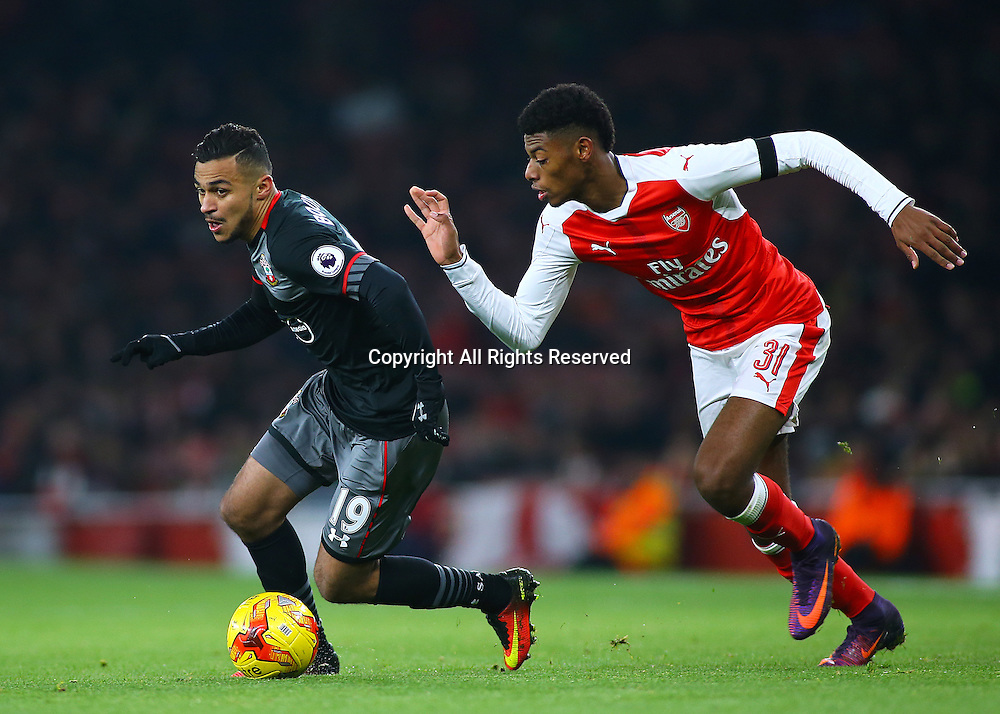 30.11.2016. Emirates Stadium, London, England. EFL Cup Football, Quarter Final. Arsenal versus Southampton. Southampton Midfielder Sofiane Boufal takes the ball past Arsenal Midfielder Jeff Reine-Adelaide