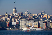 Istanbul. Ferries on the Bosporus. Galata tower and Bridge (l.)