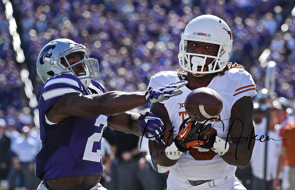 Defensive back D.J. Reed #2 of the Kansas State Wildcats brakes up a pass intended for wide receiver Armanti Foreman #3 of the Texas Longhorns in the end zone, during the second half at Bill Snyder Family Stadium in Manhattan, Kansas.