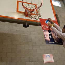 Alex Hartman, 32, hangs signs for democratic presidential candidate, Sen. Barack Obama at Reno High School, a presidential caucus site in Reno, Saturday, Jan. 19, 2008...Photo by David Calvert/Bloomberg News