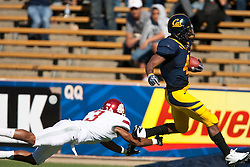 October 24, 2009; Berkeley, CA, USA;  California Golden Bears running back Jahvid Best (4) breaks a tackle by Washington State Cougars defensive back Brandon Jones (3) to score on a 61 yard rush during the second quarter at Memorial Stadium.