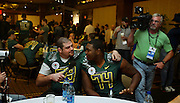 12//29/09  - The Oregon Ducks Bo Thran (69) and Darrion Weems (74) playfully give an interview during team media day Wednesday morning at the downtown L.A. Marriott.