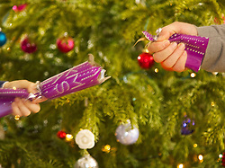 Two People Pulling Christmas Cracker