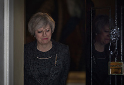 © Licensed to London News Pictures. 09/02/2017. London, UK. Prime Minister Theresa May opens the door to Number 10 to meet with Prime Minister Paolo Gentiloni of Italy in Downing Street .Photo credit: Peter Macdiarmid/LNP
