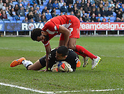 Reading's goalkeeper Adam Federici and Blackburn Rovers Lee Williamson during the Sky Bet Championship match between Reading and Blackburn Rovers at the Madejski Stadium, Reading, England on 11 April 2015. Photo by Mark Davies.