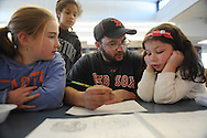 Newman School alumnus and volunteer, Erik Montplaisir, works with students Lyndsey Trundle (l) Anisha Scott (c) and Annabelle Markowitz, after speaking to students about his disability, which was a result of an aneurysm he suffered as a child.<br /> Wicked Local staff photo/Kate Flock