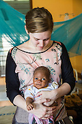 VSO volunteer Dr Siobhan Neville who specialise in paediatrics caring for 1 month old Fatiha on the children's ward. St Walburg's Hospital, Nyangao. Lindi Region, Tanzania.