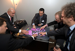 """A Microsoft representative demonstrates a $10,000 coffee table PC, the Surface. It features touchscreen technology that can sense and process multiple touches at the same time and """"turns an ordinary tabletop into a vibrant interactive surface."""" It's intended for enhancing customer experiences inside retail stores -- or perhaps creating some really cool bar games. At the moment the Surface is available only to select partners in the United States, although Microsoft was gauging a possible entry into the European market."""