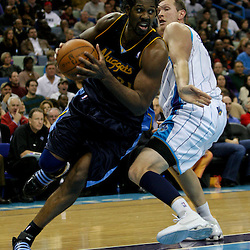 Dec 18, 2009; New Orleans, LA, USA;  Denver Nuggets center Nene Hilario (31) drives past New Orleans Hornets forward Darius Songaila (9) during the second half at the New Orleans Arena. The Hornets defeated the Nuggets 98-92. Mandatory Credit: Derick E. Hingle-US PRESSWIRE