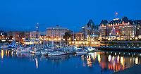The lights of the grand architecture along the Inner Harbour are reflected in the water of the Pacific Ocean, in Victoria, BC Canada
